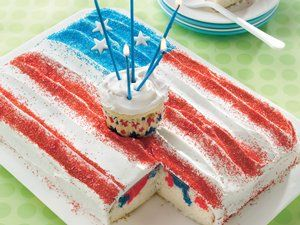 Add even more fun to your festivities by making a spirited white cake decorated with red and blue.