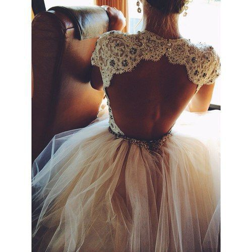 This dress is like a beautiful ballet costume, with the tulle skirt, the open back, and the lace details. ~A