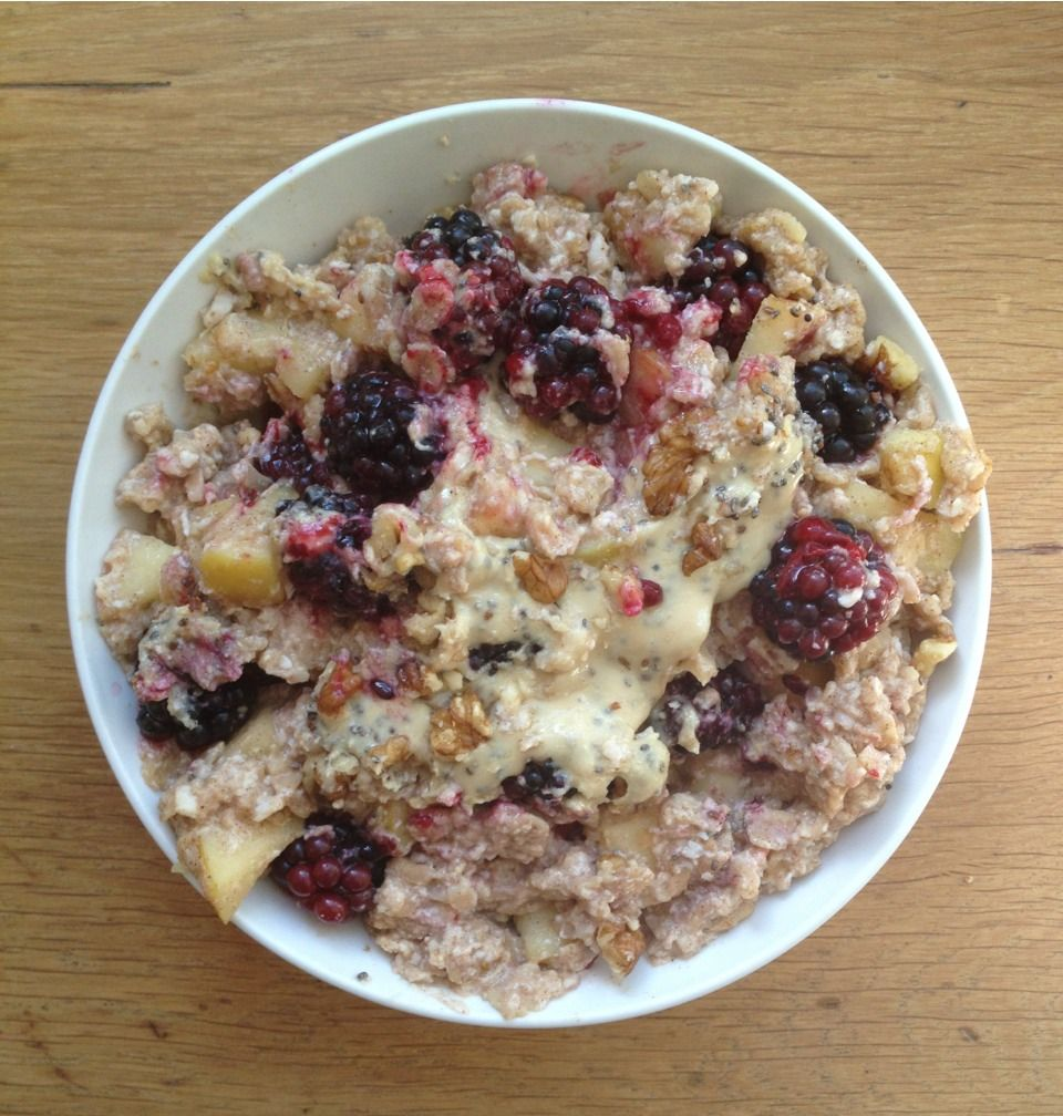 Cinnamon apple oatmeal with fresh British blackberries, chia seed peanut butter, crushed walnuts and more chia seeds.