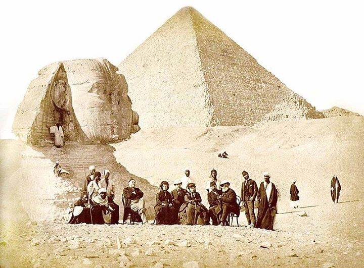 Auguste Mariette (seated, far left) and Emperor Pedro II of Brazil (seated, far right) with others during the monarch's visit to the Giza Necropolis at the end of 1871.