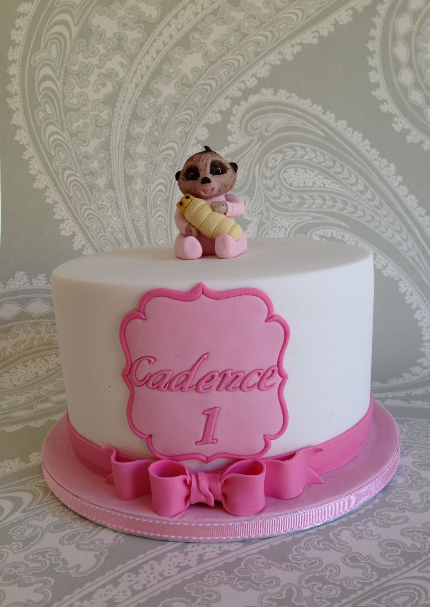 Girls first birthday cake Pink and white with Pink Bow The