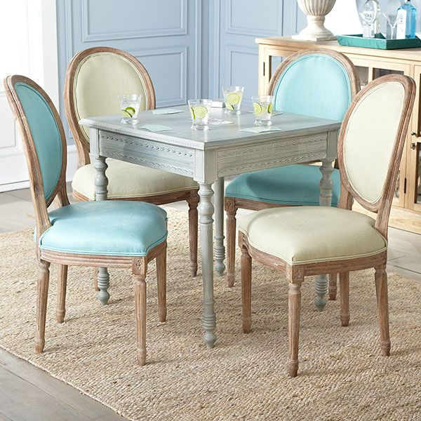 A simple yet sophisticated design gives life to the high back Louis XVI dining chair. Padded with linen fabric for comfort, this rustic chair features a weathered brown oak wood frame and is accented with sage green upholstery.