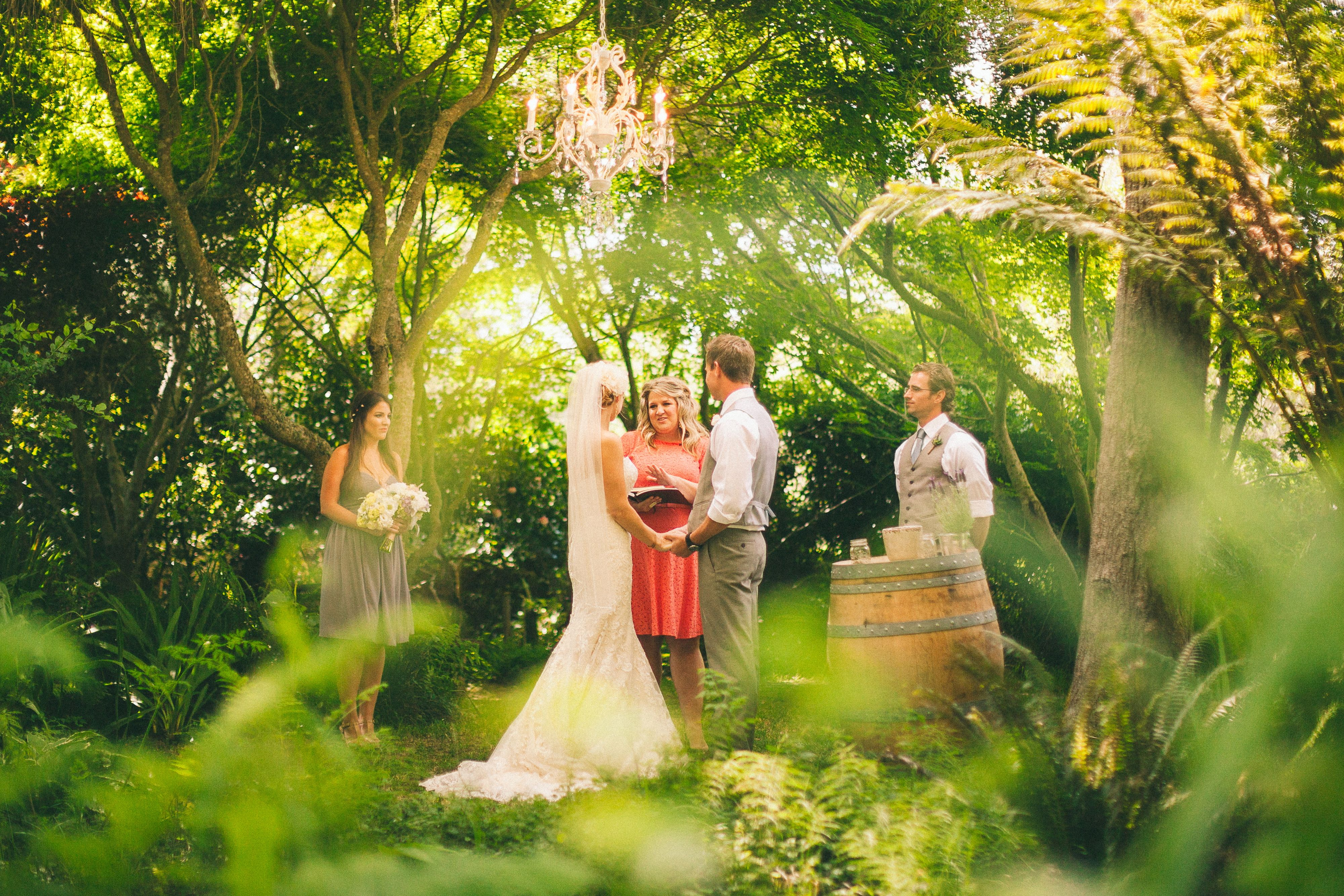 Rustic garden wedding chandelier ceremony Compass Rose