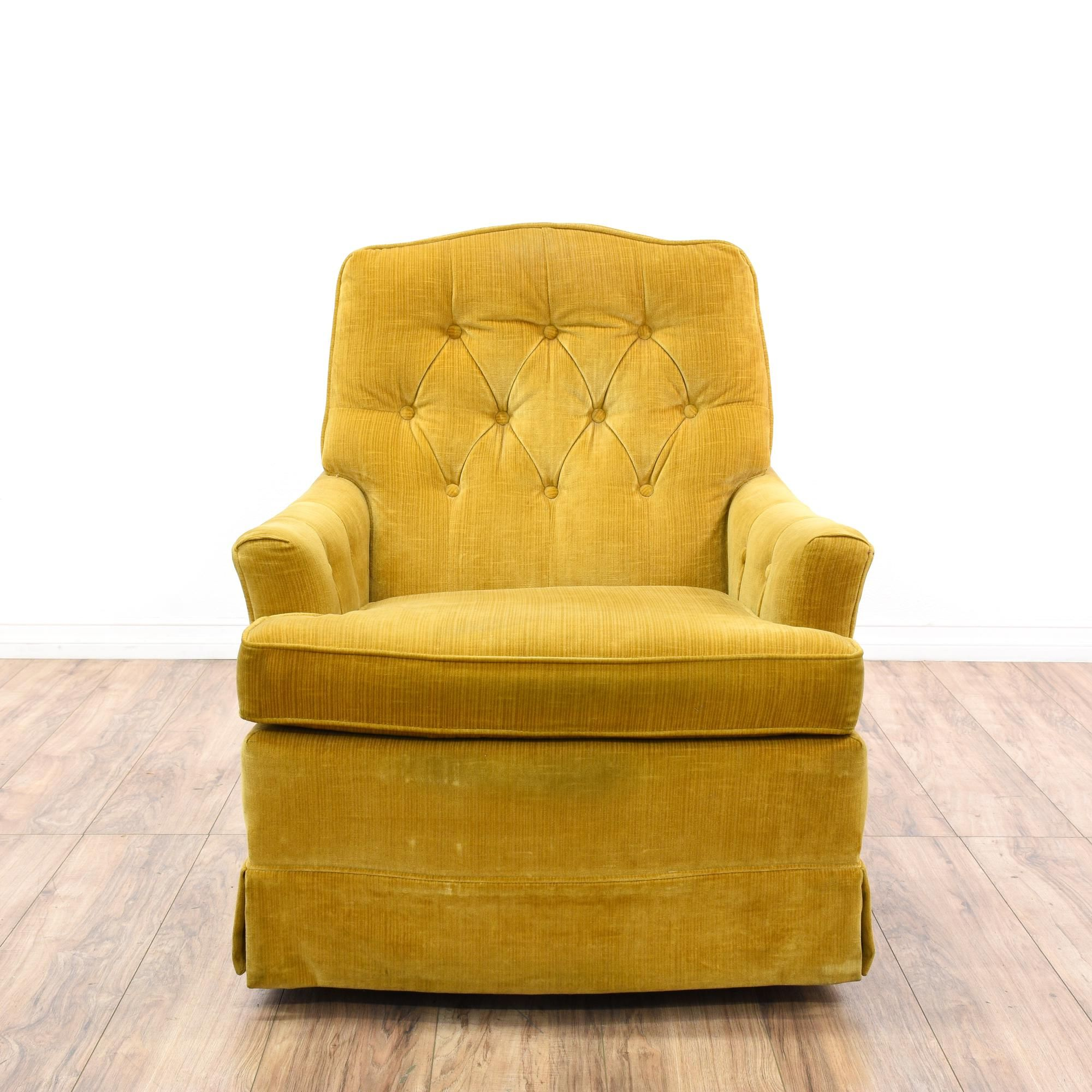 This accent chair is upholstered in a durable mustard yellow