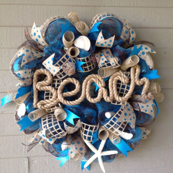 Hey, I found this really awesome Etsy listing at https://www.etsy.com/listing/181216384/beach-seashell-burlap-deco-mesh-wreath