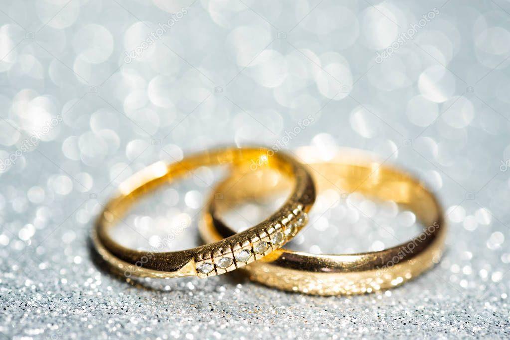 Gold wedding rings. Glitter background - Stock Photo , #SPONSORED, #rings, #wedding, #Gold, #Glitter #AD #goldglitterbackground