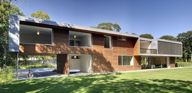 Maison contemporaine bois et béton évoquant le camping et le plein ...