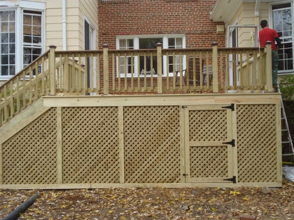 Add your outdoor living space with deck railing ideas how for Exterior timber decking