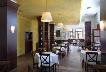 restaurant interior: Modern restaurant interior tables and chairs prepared for guests. Stock Photo