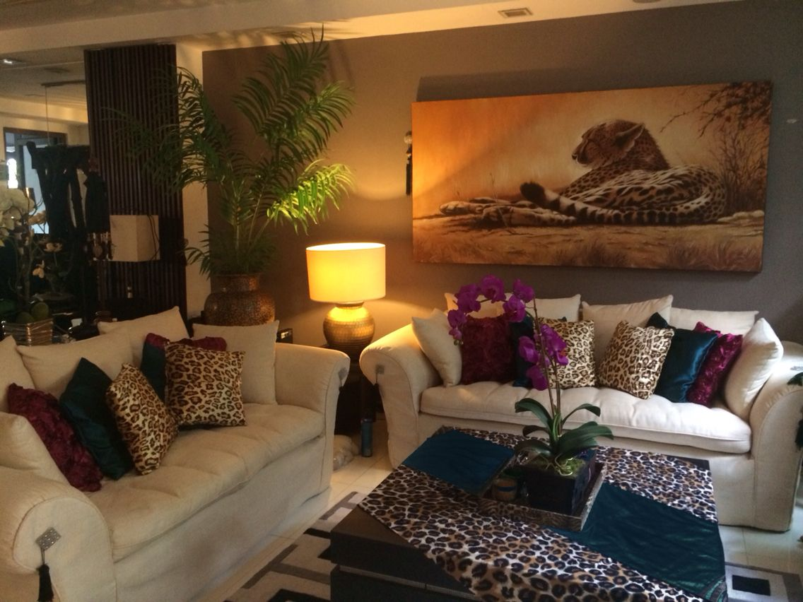 Burgundy teal and leopard print living room decor same room different look living room decor for Leopard print living room ideas
