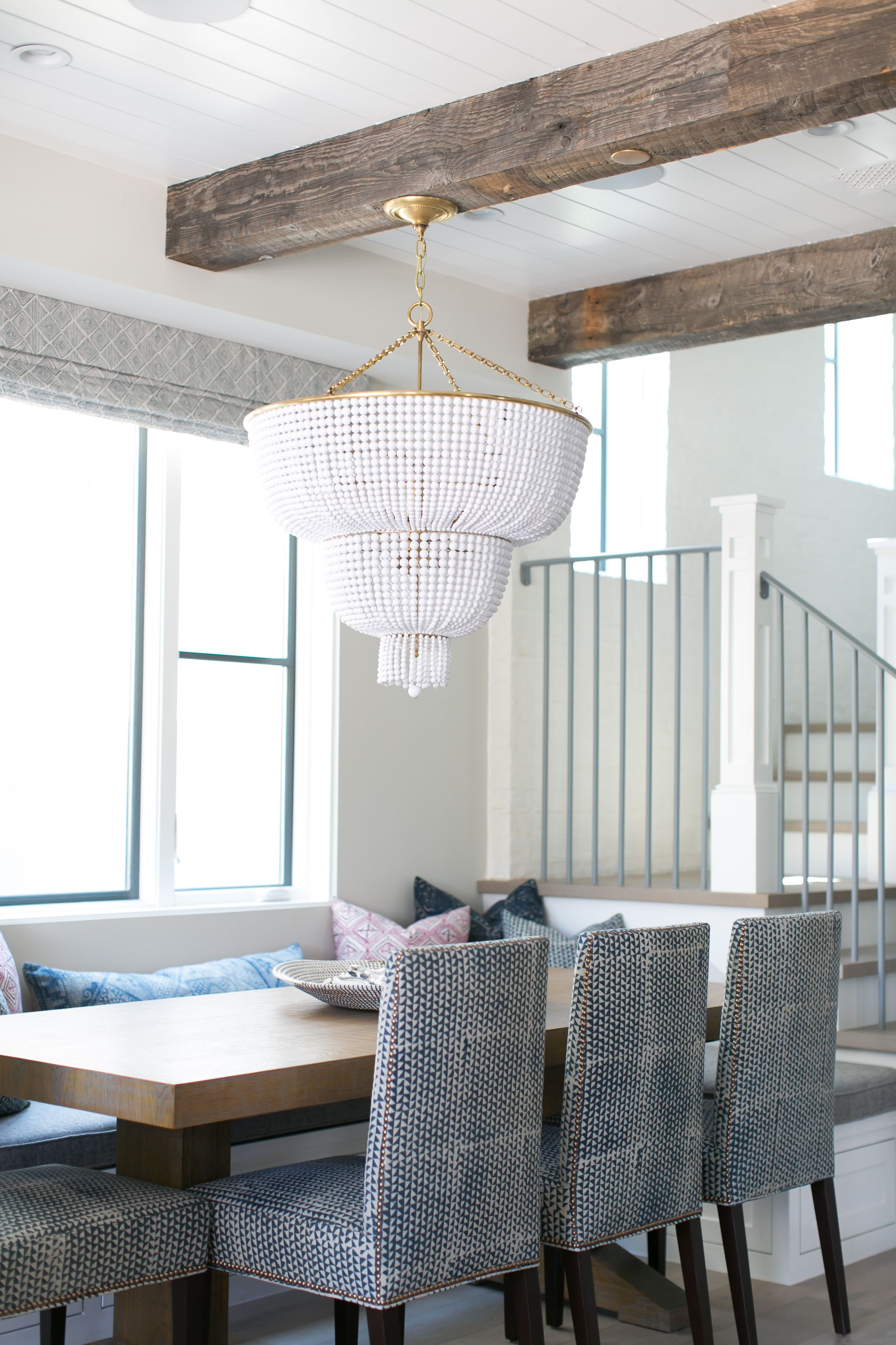 Lovely Dining Nook Boasts Rustic Wood Ceiling Beams And A White Beaded  Chandelier Hanging Over A Built In Banquette Window Seat Facing A Chunky  Wood Dining ...