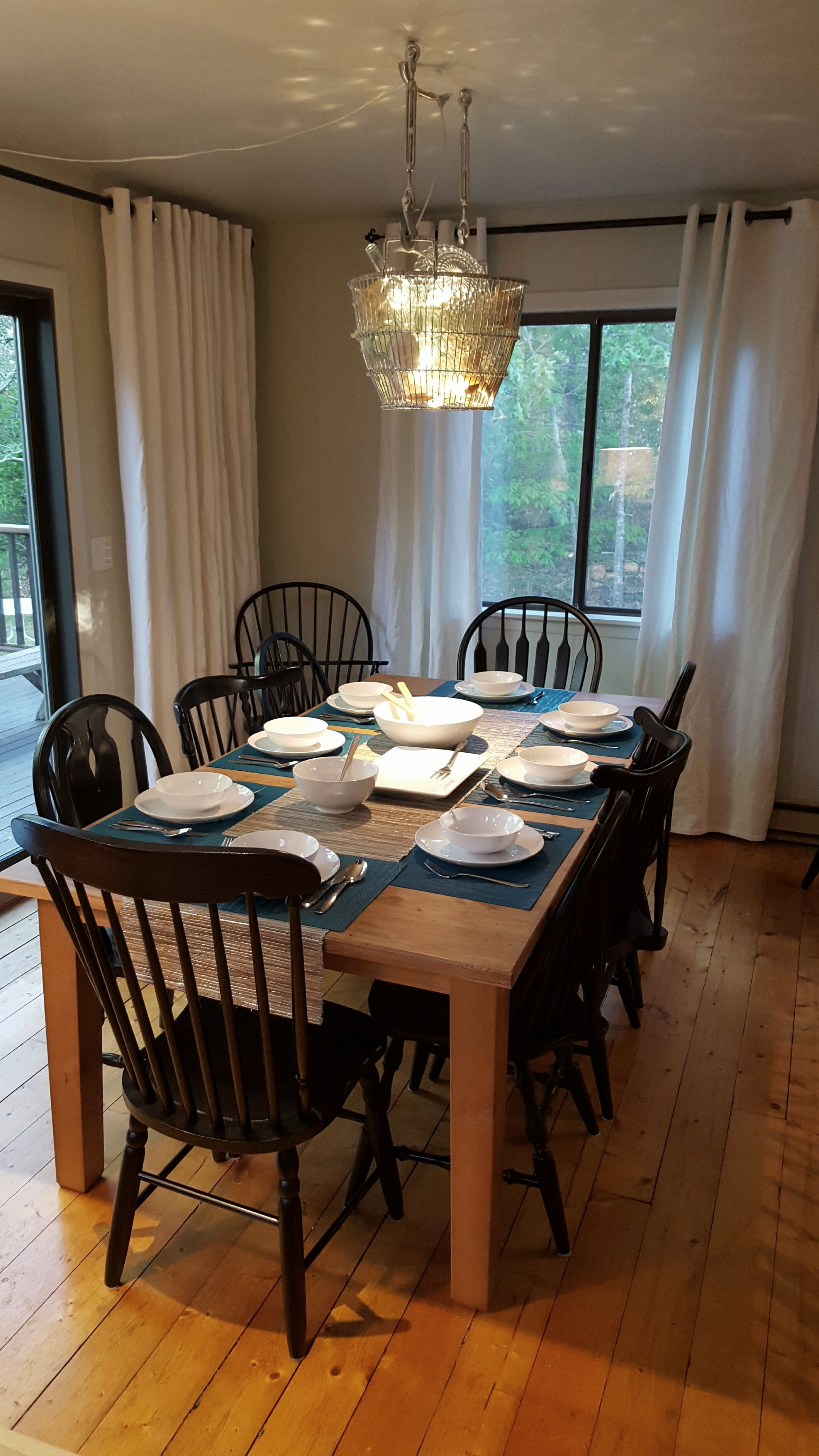 Mismatched Dining Chairs a collection of mismatched spindle back dining chairs is unified