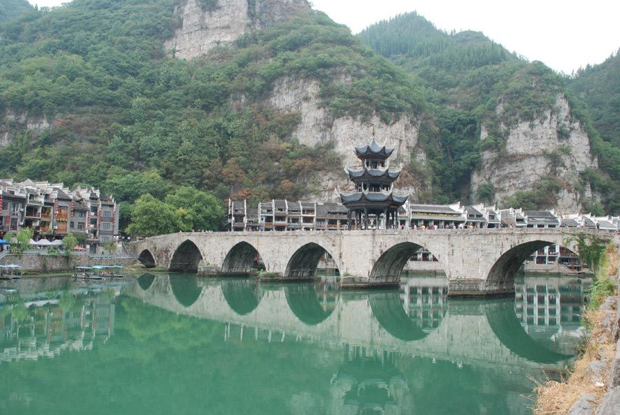 Wuling Mountains   Old Zhenyuan seen during the day. Green mountains surround the city ...