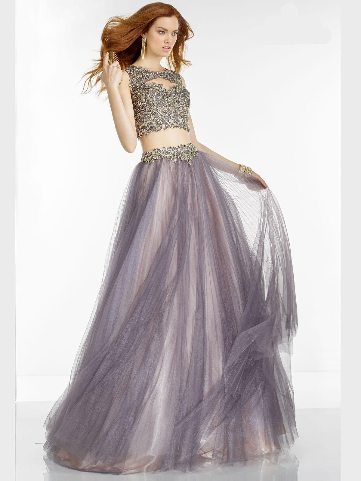 This fabulous two piece ball gown is sure to turn heads at your prom
