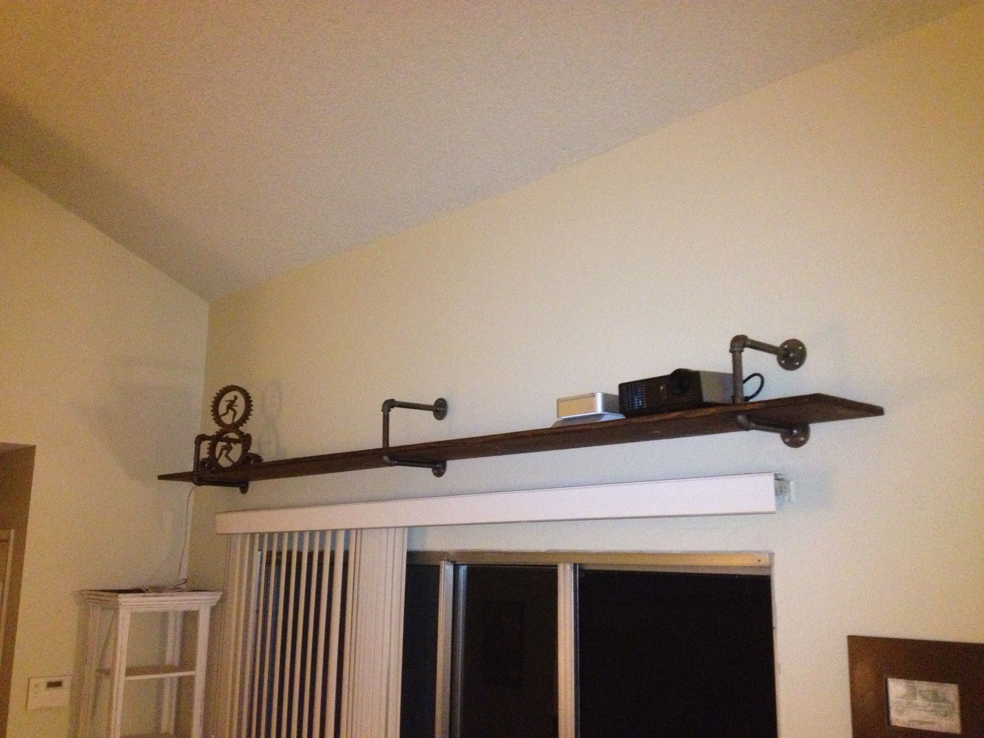 Elevated Shelf Utilizing Galvanized Pipe For Placement