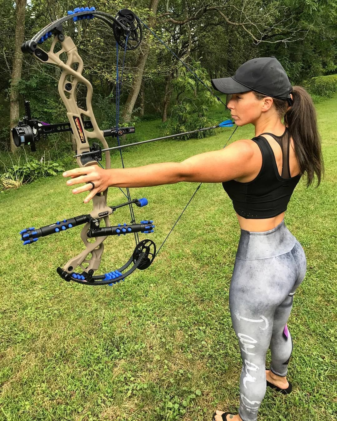 Hot chicks shooting bow and arrow