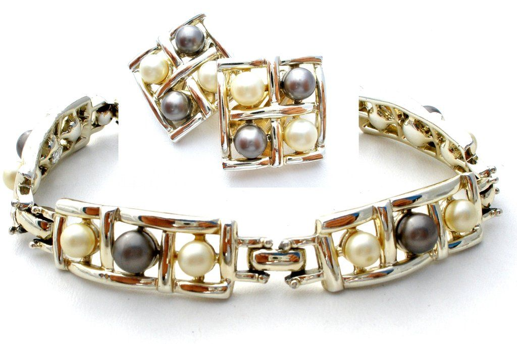 Designer Signed Jewelry with Pearls - This is a Sarah Coventry silver tone pearl bracelet and clip on earring demi set. The set has creamy white and gray faux pearls and all pieces are signed SC for S