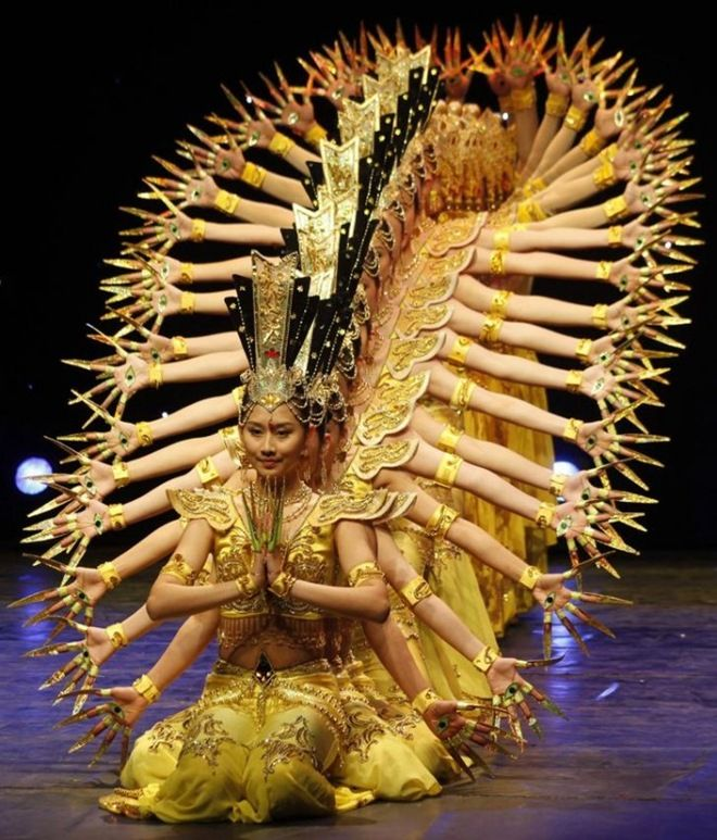 """The Chinese troupe of disabled In the formulation used in Buddhist ritual dances, including the famous """"dance of a thousand-hand Bodhisattva Kuan Yin, the Goddess of Mercy."""