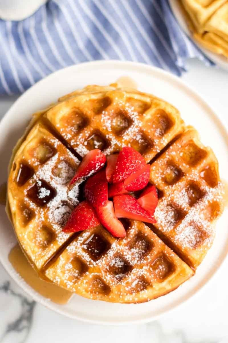 Stack Of Buttermilk Waffles With Syrup Powdered Sugar And Strawberries In 2020 Homemade Waffles Buttermilk Waffles Waffles Recipe Homemade