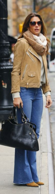 Who made Cindy Crawford's tan suede jacket and blue flared jeans?