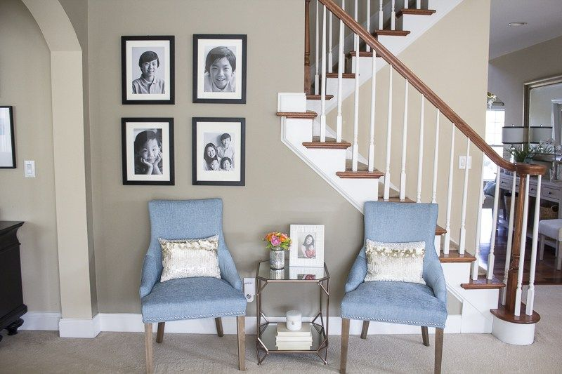Tips on how to brighten a dark living room with dark couches.