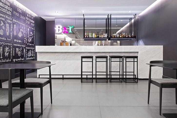 - cookery performance - vladimir silantyev - neon letter - bar - white amble - artwork - black & white - design - schwarz weiß - leuchtbuchstaben - leuchtschrift - barhocker - tresen