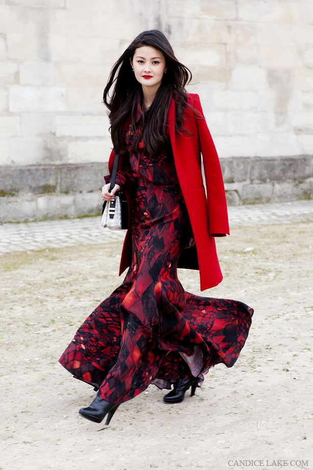 Peony Lim in a triple crepe silk snake printed maxi skirt and shirt by Isolda, coat by zara and emm kuo bag.