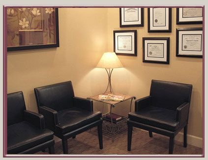 waiting room note degrees or certificates on wall gives it