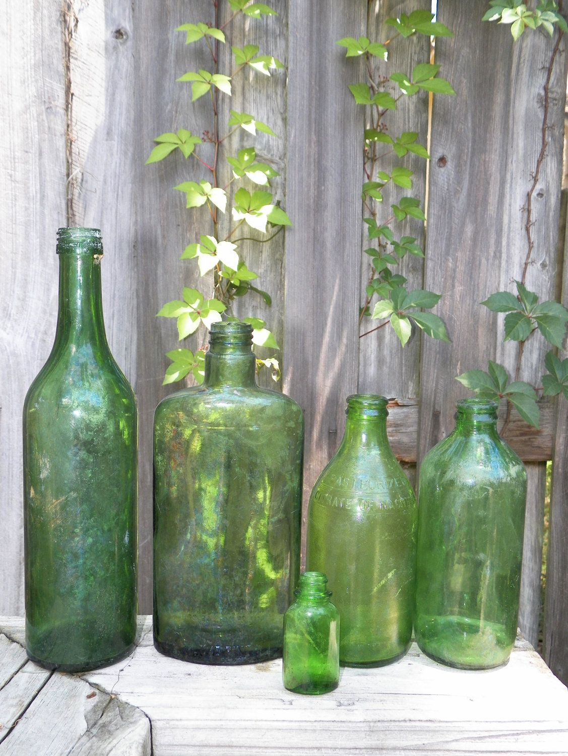 love this green bottles pinterest bottle glass bottle and glass lot of vintage green glass bottles set of 5 mixed weathered nature made patina craft supply home decor
