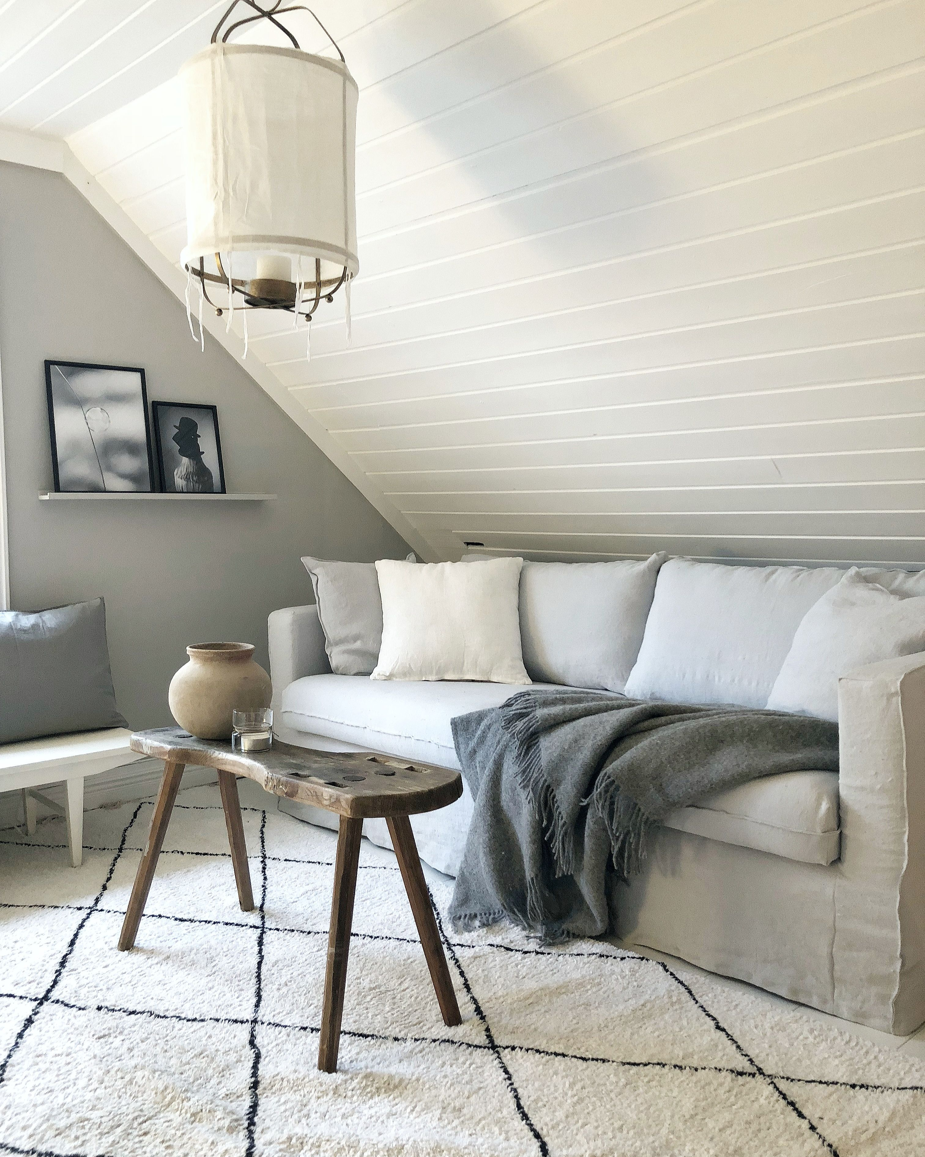 white and grey living room featuring an beni ourain and rustic ...