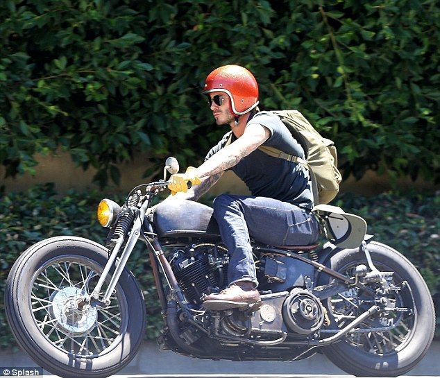 David Beckham cuts loose as he takes a ride on his motorbike in ...