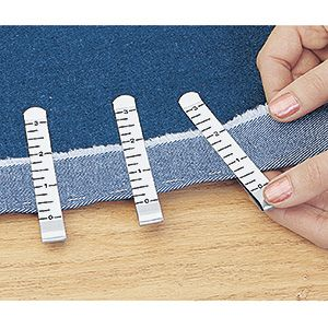 I could have used this years ago... HEM CLIPS.  Measure and hold hemming projects without pins! Smooth, stainless steel clips slide onto fabric and hold hem in place while you sew or baste. Built-in measure assures straight, accurate hemlines every time, without tedious pinning (or pricked fingers!). Ideal for skirts, dresses, drapes.  $9.98/set of 12