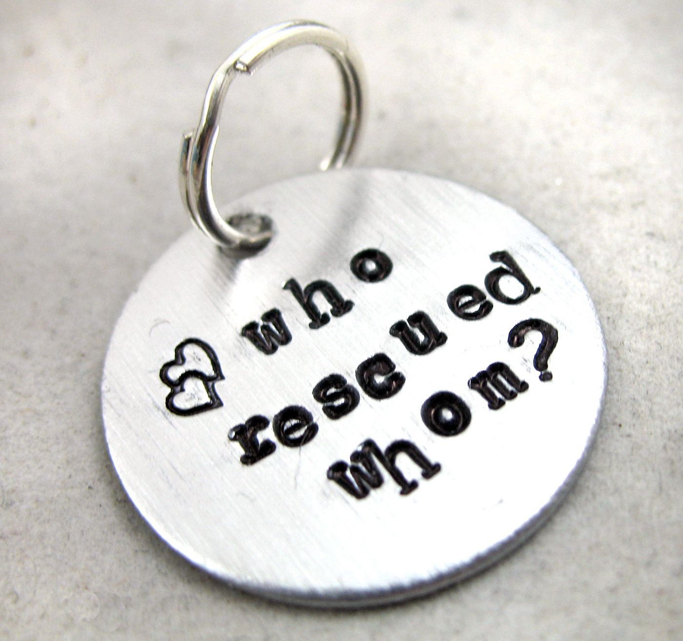Who Rescued Whom - Pendant or Dog Tag, Hand Stamped Brushed Aluminum Disc. $9.95, via Etsy.