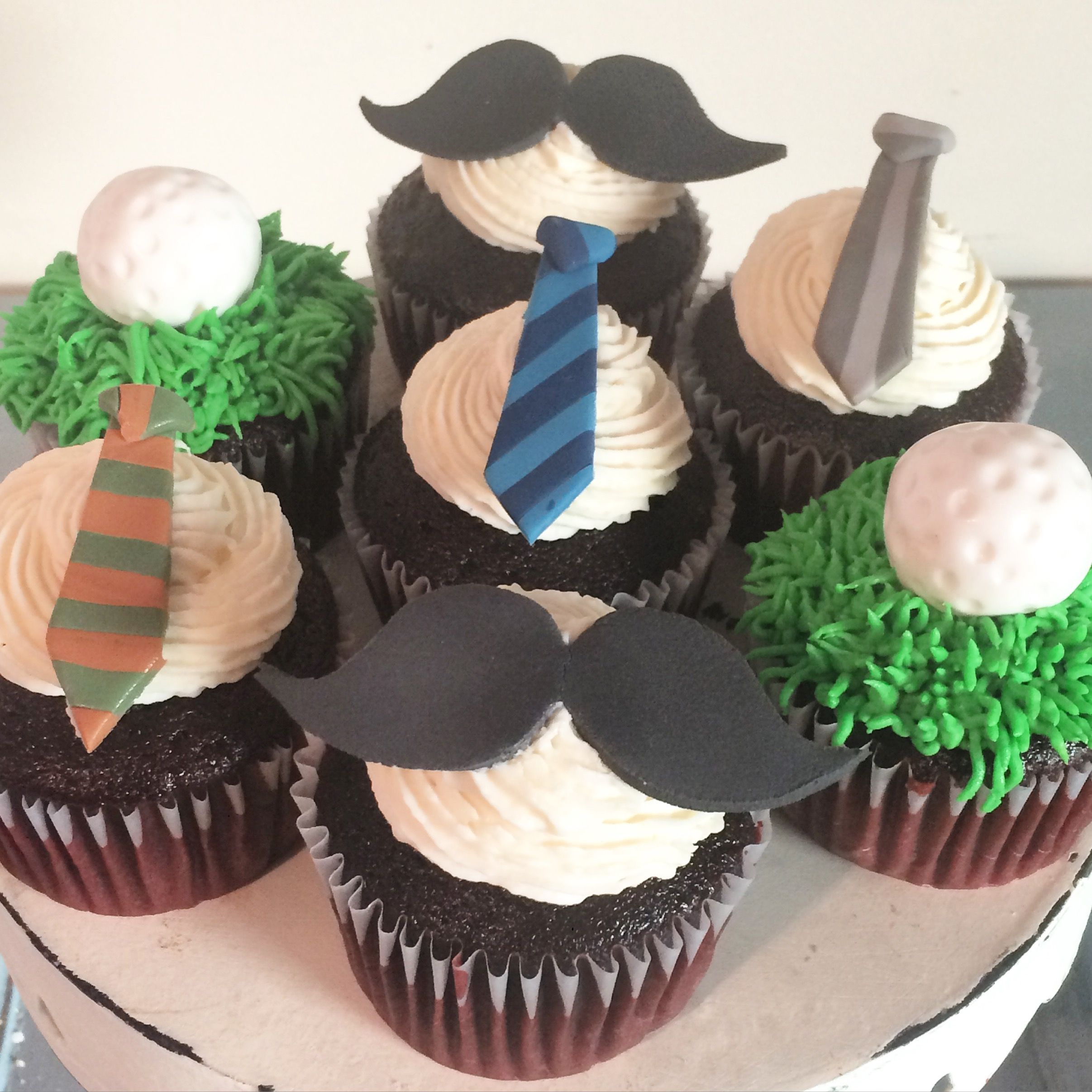 Father's Day cupcakes with ties, mustaches, golf balls