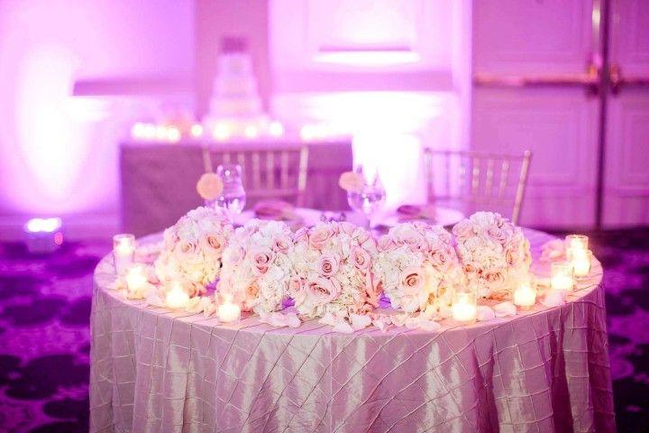 wedding ceterpiece idea: reuse bridesmaid bouquets as centerpieces; photo: Ashley Bartoletti
