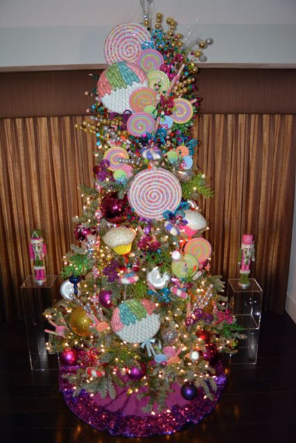 candyland christmas tree decor with colorful lollipop ornaments whimsical peppermint swirls and lots of glitter