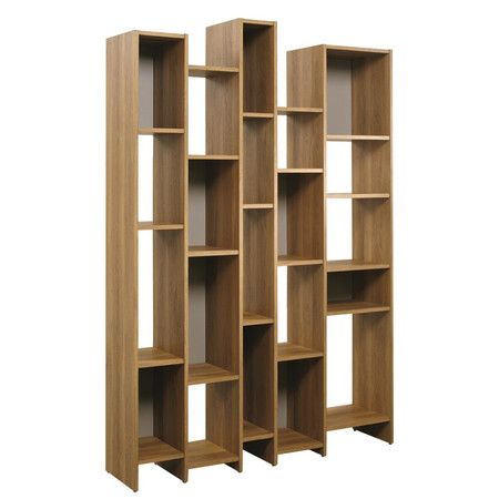 This Eye Catching Bookshelf Showcases Asymmetrical Cubbies Perfect For Stacking Leather Bound Tomes Modern Wall Shelf Contemporary Wall Shelf Modern Bookcase