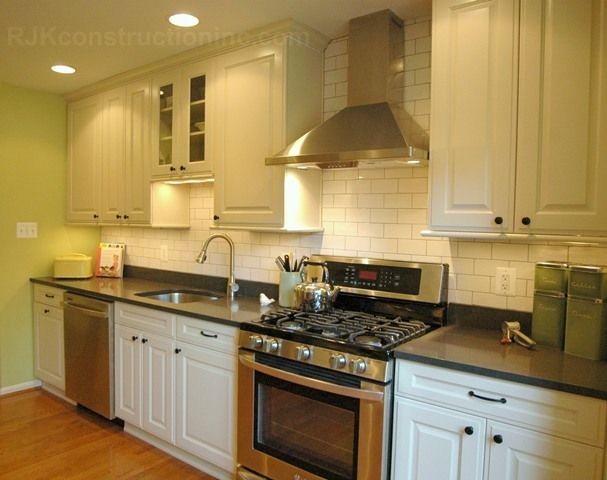 Caeserstone Raven Counter With White Cabinets Oil Rubbed
