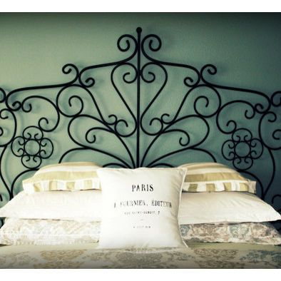 Wrought Iron Headboard With White And Tan Bedding And Blue Walls