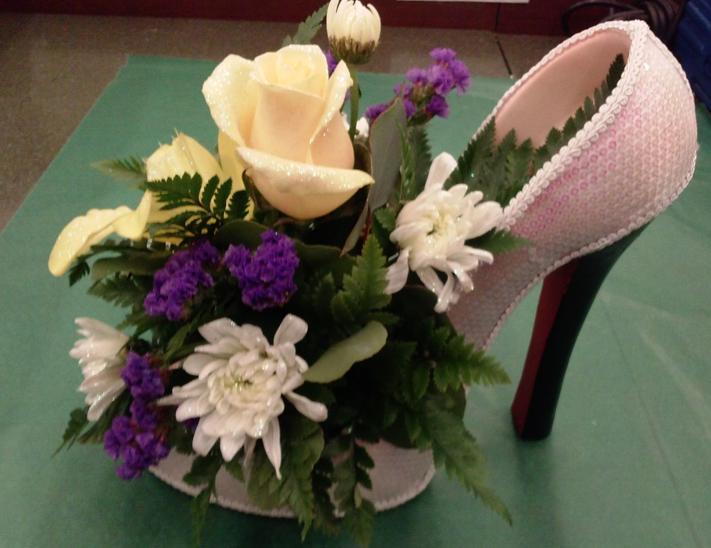 High heels floral centerpiece hanging arrangement