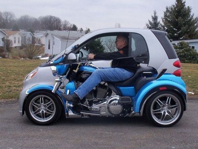 This Is A Smart Car With Photographic Wrap To Make It Look Like The Driver Riding Motorcycle