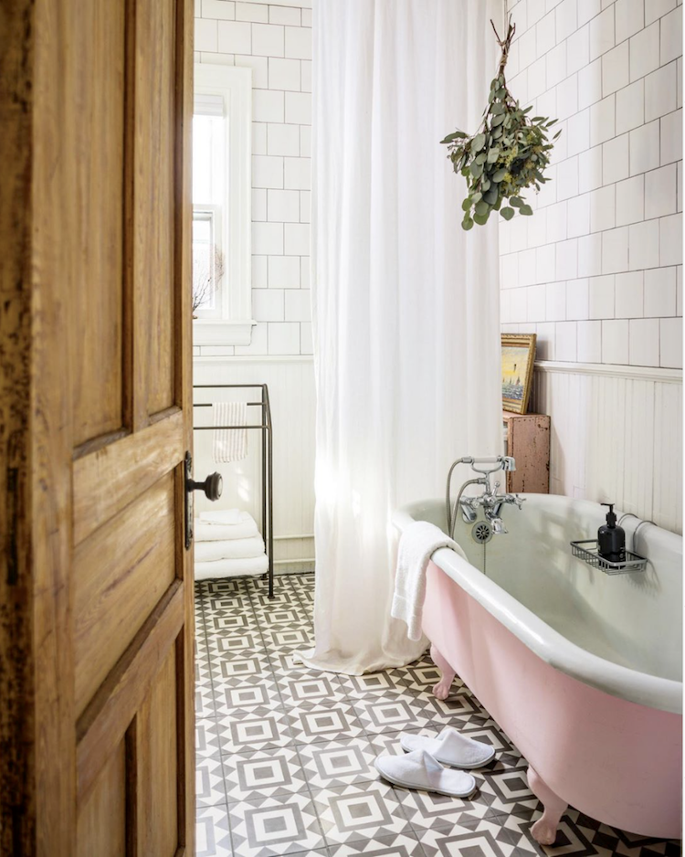 Old School Style Bathroom With Black And White Tiles And A Pink