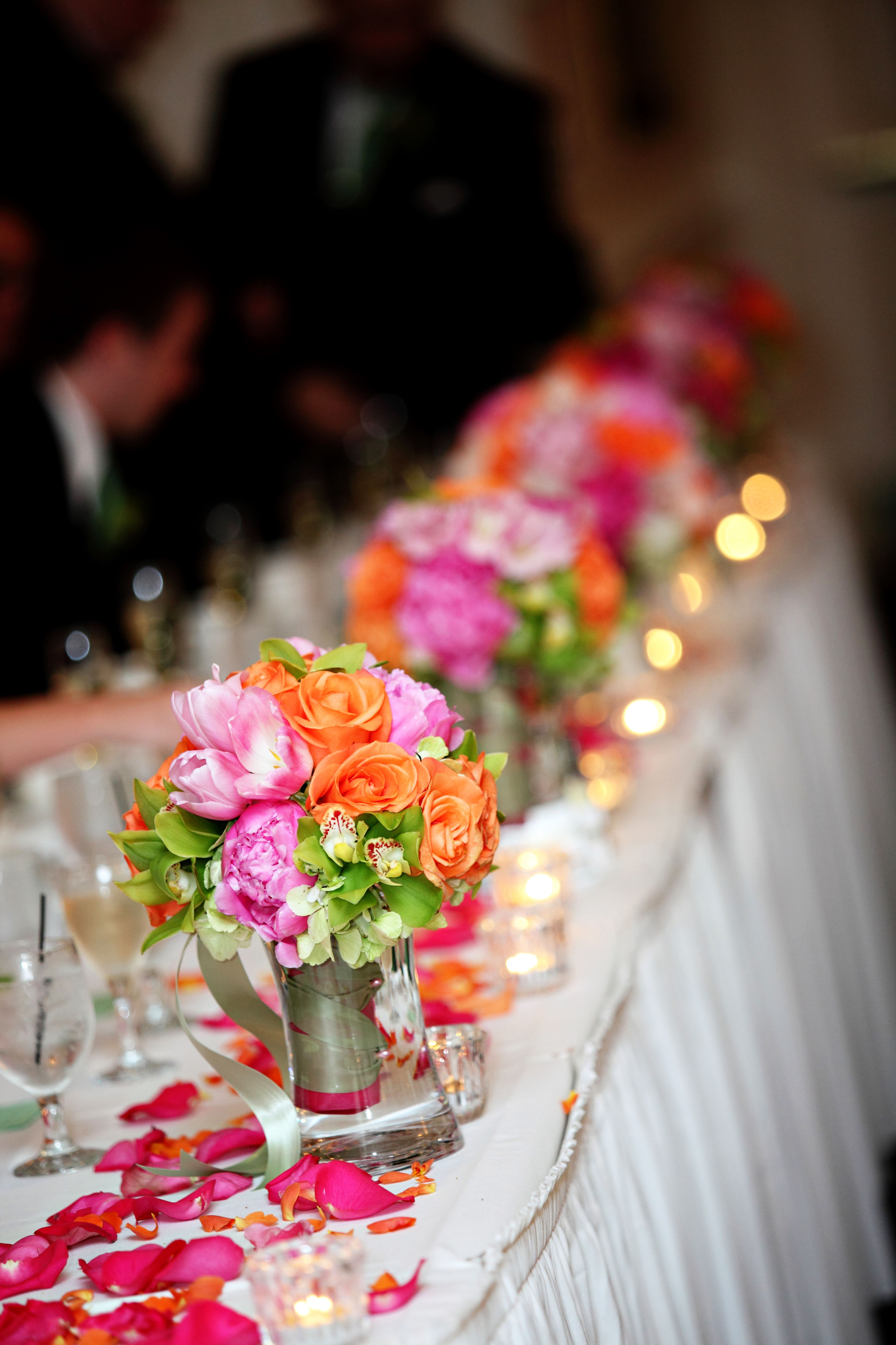 Bridesmaids Bouquets Line The Head Table With Fresh Petals