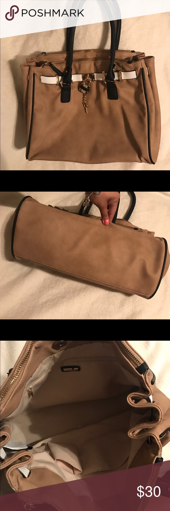 Aldo Satchel Tan Aldo satchel with black handles and gold accents! Used but in good condition. Has a small black mark as shown on the last pic not noticeable and a small jean rubbing mark on the back of the purse. Let me know if you have questions. Aldo Bags Satchels