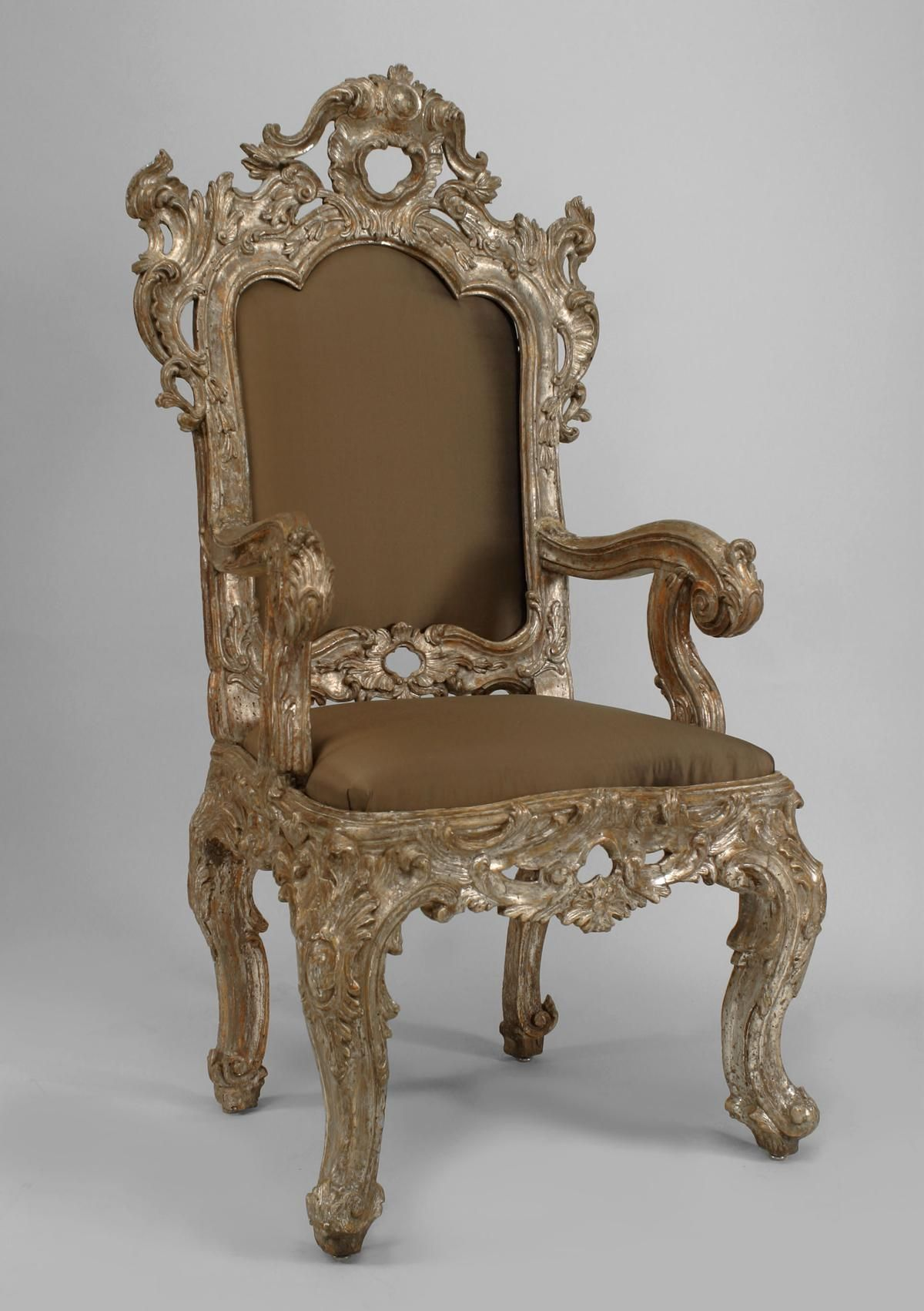Pair of antique Italian Rococo high back silver-gilt carved throne chairs  with beige upholstered seat and back panels. $75,000.00 USD - Pair Of Antique Italian Rococo High Back Silver-gilt Carved Throne