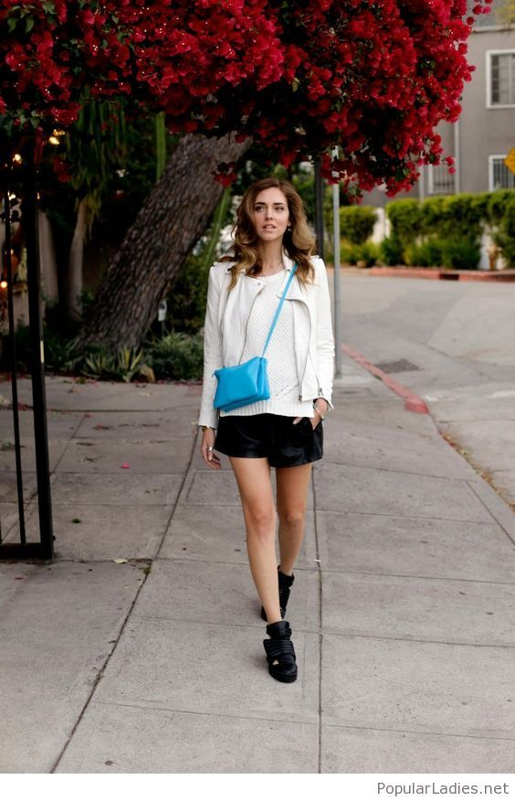 black-shorts-white-top-and-jacket-with-a-blue-bag