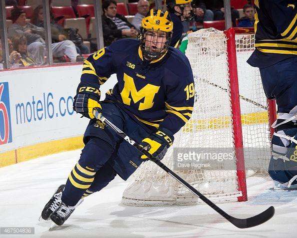 Dylan Larkin Of The Michigan Wolverines Skates Around The Net Against Michigan Wolverines College Hockey Michigan