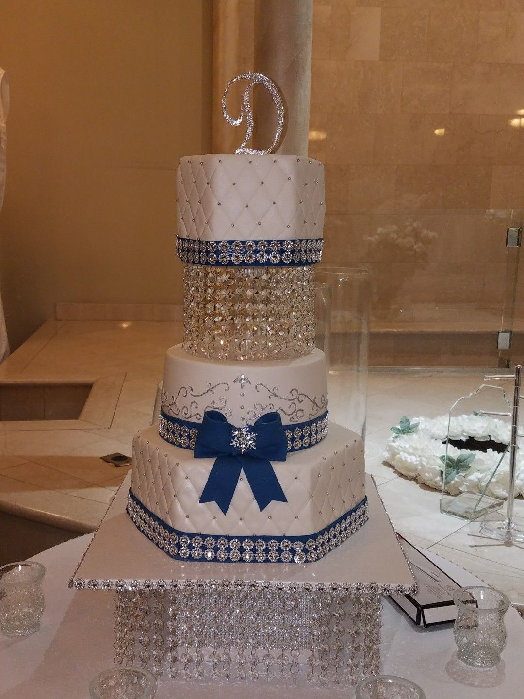 Three Tiered White And Royal Blue Wedding Cake With Bling And Crytsal Seperators And Crystal Stand Silver Wedding Cake Wedding Cakes Blue Bling Wedding Cakes