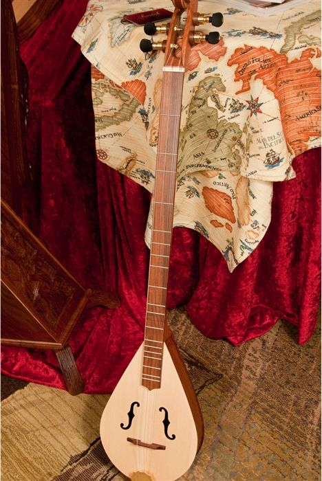 The Roosebeck Wildowwd Stick Dulcimer is fun, lightweight, and easy to play. Guitar style stick Dulcimer with the rich sound of a mountain dulcimer with just a little bit of banjo twang.