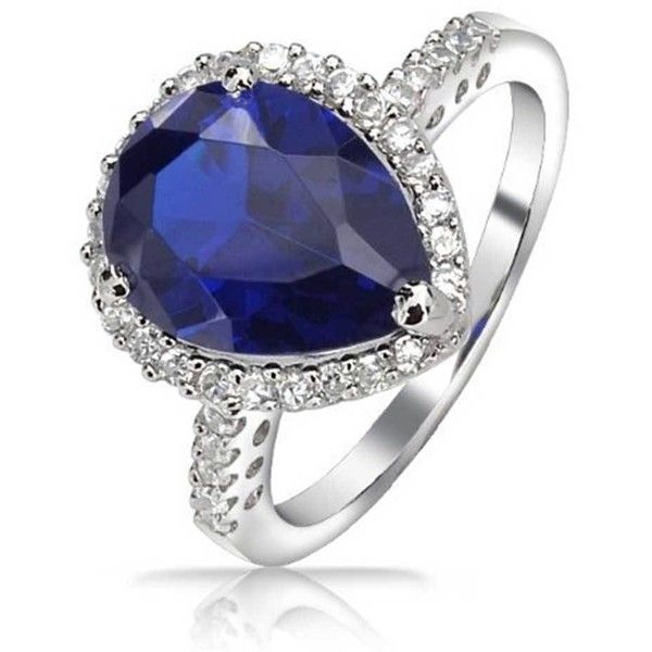 Vintage 925 Silver Teardrop Sapphire Color CZ Engagement Ring 3ct ($28) ❤ liked on Polyvore featuring jewelry, rings, birthstones, blue, vintage sapphire rings, vintage style rings, cz engagement rings, blue wedding rings and vintage wedding rings